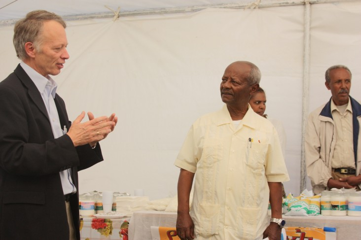 USAID Mission Director Dennis Weller (left) tours Ada'a Dairy Cooperative factory in Debre Zeit
