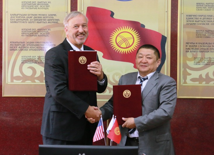 USAID Mission Director Gary Linden and Minister of Health Kosmosbek Cholponbaev exchange the signed statements.