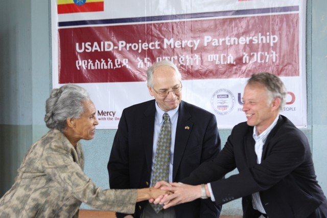 Project Mercy Executive Director Marta Gabre-Tsadick (left) and USAID Ethiopia Mission Director Dennis Weller shake hands