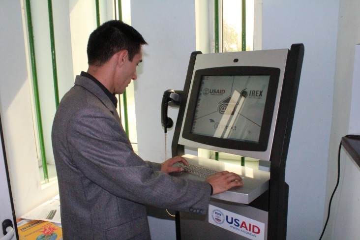 A community member connects to the virtual world through an internet kiosk