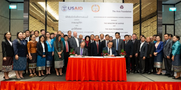 From center left to right: U.S. Ambassador Rena Bitter and Minister of Justice Mr. Xaysi Santivong witnessed the MOU signing between Mr. Todd Wassel, Country Representative for The Asia Foundation in the Lao PDR and Mr. Ketsana Phommachanh, Director General of International Cooperation, Ministry of Justice.