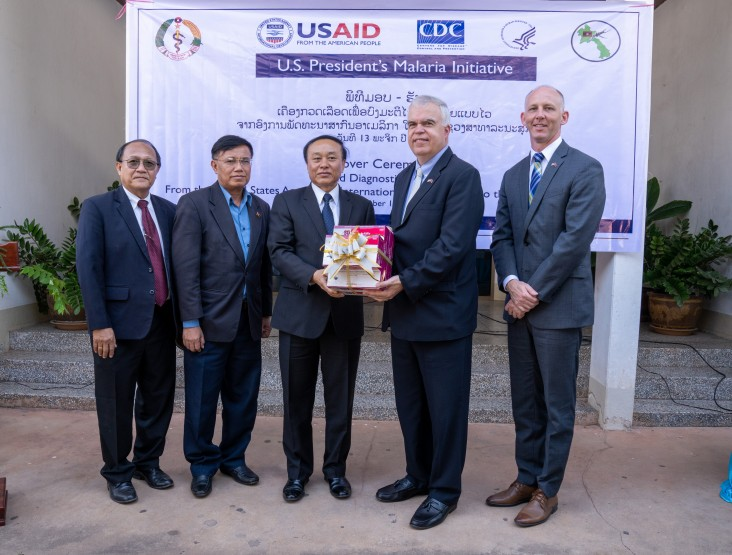 From left to right: Vice Minister of Health Dr. Bounfeng Phoummalaisith receives 50,000 USAID-donated malaria test kits from U.S. Ambassador to the Lao PDR Dr. Peter M. Haymond at a ceremony in Vientiane on November 13.