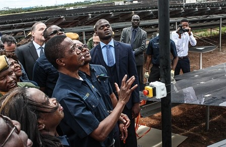President of the Republic of Zambia Edgar Lungu prepares to power on the Bangweulu Solar farm during the plant's commissioning in Lusaka on March 11, 2019.