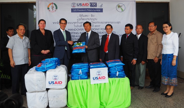 From (third left) U.S. Deputy Chief of Mission to Lao PDR Michael Kleine presented 120,000 mosquito nets to the Deputy Minister of Health, H.E. Assoc. Prof. Dr. Phouthone Muongpak during a ceremony in Vientiane.