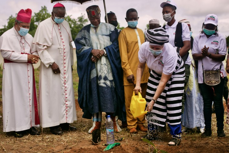 """On July 16th,""""Shea Day"""", U.S. Ambassador to Ghana Stephanie S. Sullivan watered a newly transplanted shea seedling, at the Jakpa Palace in Damongo, as the Buipewura Jinapor II, Archbishop Philip Naameh, and Most Reverend Peter Paul Yelezuomeng Angkyier look on."""