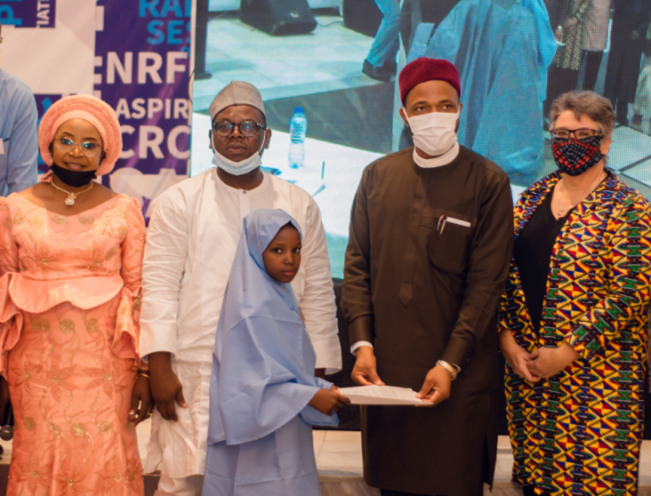 Minister of Education for State, Honorable Emeka Nwajiuba acknowledging the presentation from Aminatu Ammar a primary school pupil and beneficiary of the NEI Plus activity at the close-out ceremony in Abuja