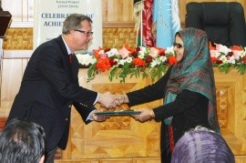 USAID Deputy Mission Director James Hope presents a letter of appreciation to Anisa Rasooli, Head of the Afghan Women Judges Ass