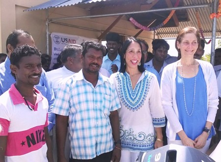 U.S. Ambassador Michele Sison and USAID Mission Director Sherry F. Carlin with local fishermen