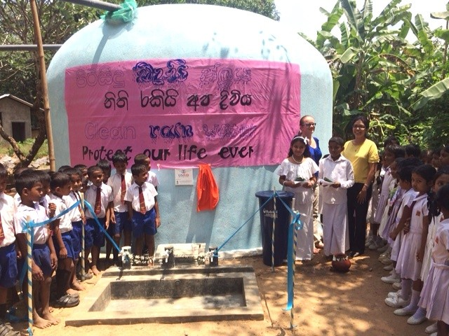 Students at Keselpotha Maha Vidyalaya in Uva Province celebrate the launch of their school's U.S. Embassy-supported rainwater harvesting system.