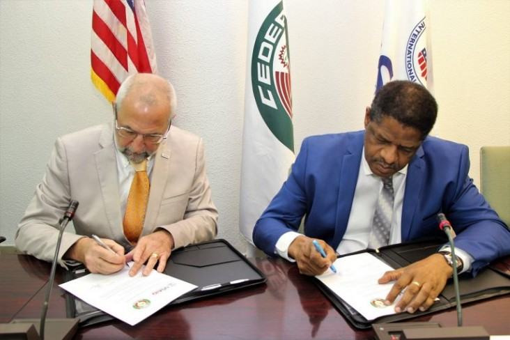 USAID/WA Mission Director, Alex Deprez and ECOWAS President sign agreement
