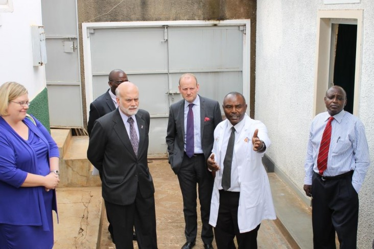 Dr. Bemera guides Amb. DeLisi (2nd left) and his Swedish counterpart Urban Andersson (3rd right) around his clinic.