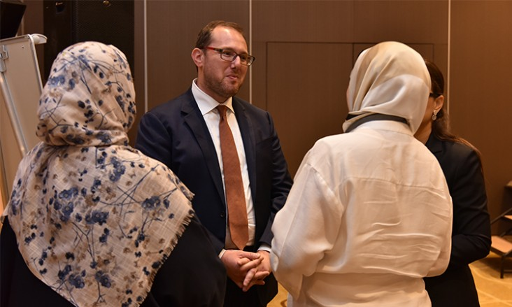 The Libya External Office Chargé d'Affaires a.i. Josh Harris speaks with participants at the Libya Women's Economic Empowerment Conference
