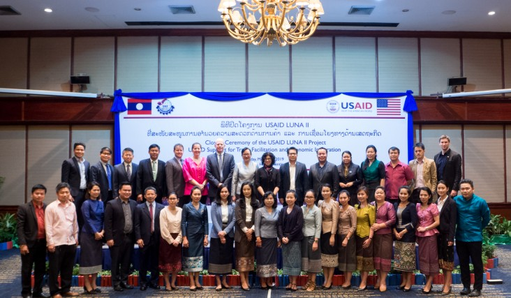 U.S. Ambassador Rena Bitter (top row, center) joins Minister of Industry and Commerce Khemmani Pholsena and 40 other representatives from the Lao government, the U.S. Embassy, and the private sector during the closing ceremony of the USAID LUNA II project in Vientiane.