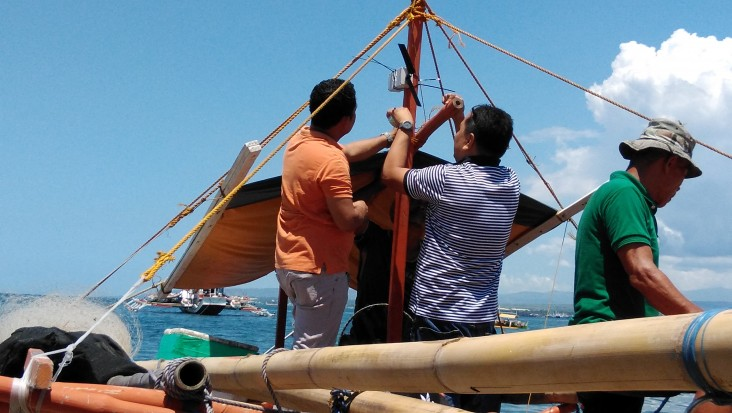 A transponder is installed on a small-scale vessel outside of General Santos City, the Philippines.