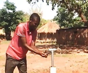 A rural resident in Zambia's Eastern provinces accesses piped water for the first time.