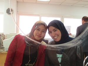 Two Port Said Tamayouz Center case agents who received customer service training through USAID follow the 'service with a smile'