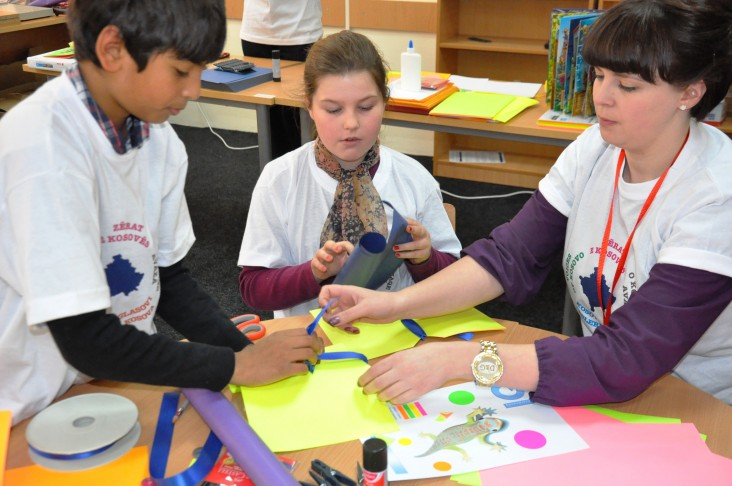 English speaking students from American School of Kosovas and their teacher during bookmaking activity.