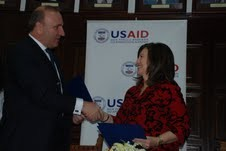 Rector Ibrahim Gashi (left) and USAID Mission Director Maureen A. Shauket (right) formalize an agreement to support improvements