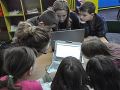 Students using new Classmate laptops