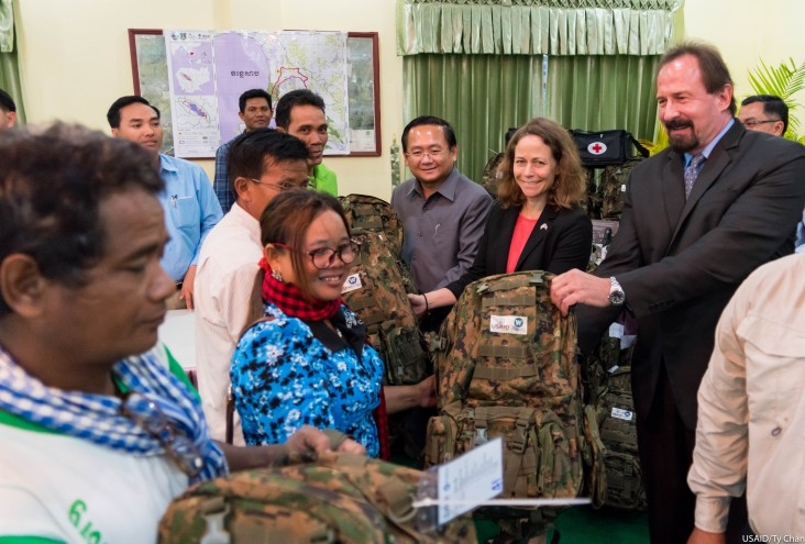 Mission Director Polly Dunford handed over forest patrol equipment to members of Prey Lang Community Network and Prey Lang Forest Community Network.
