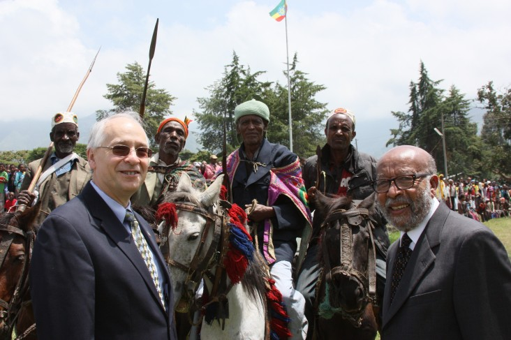 U.S. Ambassador Donald Booth (l) and Project Mercy Co-founder Deme Tekle-wold with local residents in a Gurage celebration.