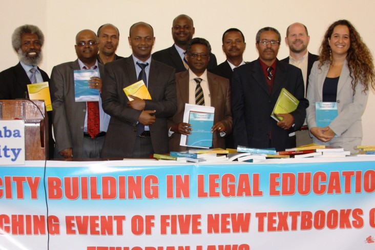 USAID, American Bar Association and AAU officials join the authors of the new law books.