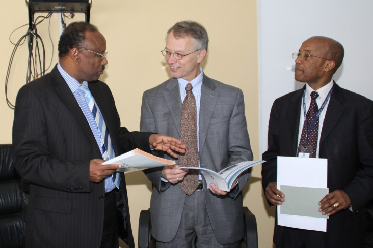 USAID Ethiopia Mission Director Dennis Weller discusses new textbooks with Ministry of Education officials.