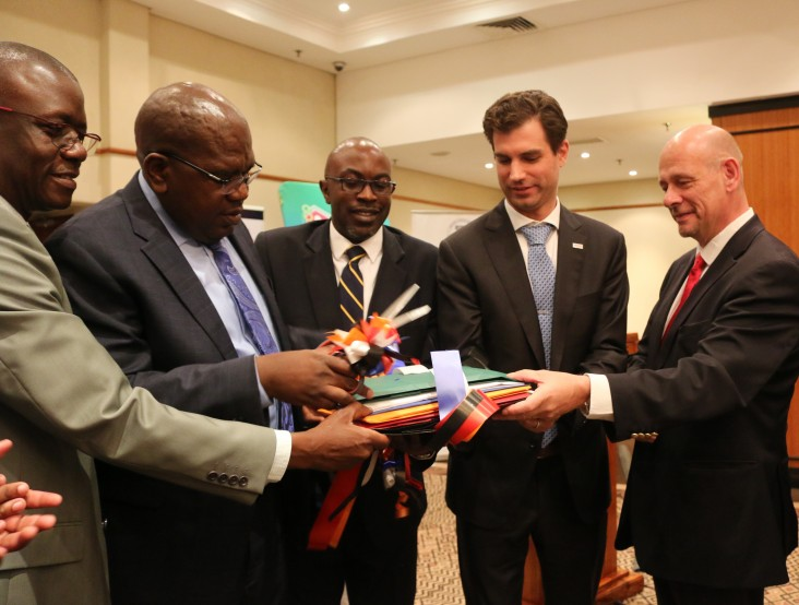 USAID Health Director John Kuehnle and the Minister of Health Chitalu Chilufya cut the ribbon on the Health Sector Supply Chain Strategy