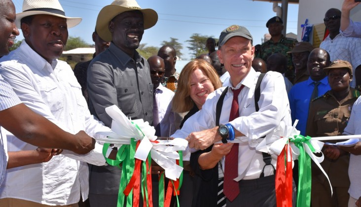 U.S. Ambassador to Kenya, Robert Godec, cuts the ribbon to official open the Lodwar Livestock Market. With him is USAID's Deputy Mission Director Heather Schildge, the Governor of Turkana County, Josphat Nanok and the Cabinet Secretary for Arid and Semi-arid Lands Eugene Wamalwa.