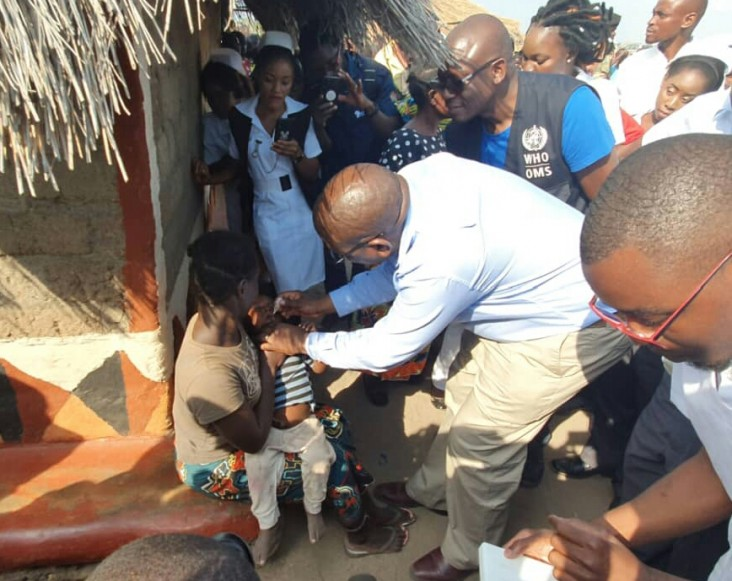 Zambia's Minister of Health administers an oral polio vaccine in 2019