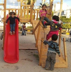 Children of Benghazi play at park improved by USAID assistance