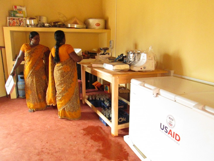 Women from Kallappadu North set up operations at their newly opened food processing center.