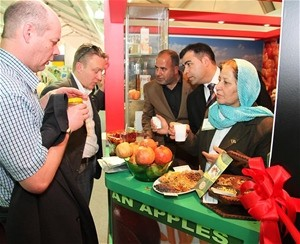 International buyers sample Afghanistan's produce, including dried fruit and nuts, pomegranates, and honey at Gulfood 2011 in Du