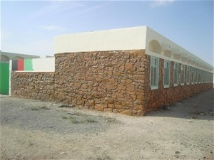 Kandahar residents worked with the international community to refurbish the Aloku School in Dand district, Kandahar province.
