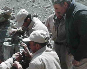 Kormal (top center) works with other rangers to set up a camera trap in the Wakhan. Under his leadership, they became the first