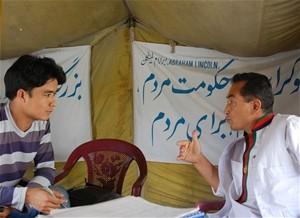 "An editor with the program (left) completes an interview as part of the ""Weekly Interview"" segment of the website."