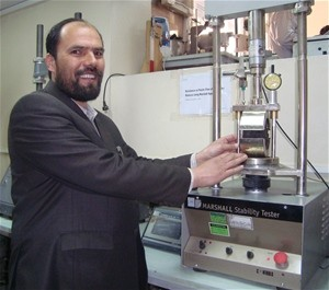 Engineer M. Eshaq, the senior lab manager at the Kabul Central Laboratory, demonstrates one of the quality control instruments t