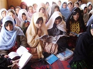 Women learn to read in a literacy class established by the community development council.