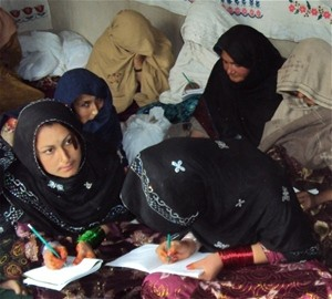 The women of Kahrotai Village are pleased to have the opportunity to take skills and literacy courses.