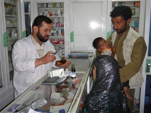Pharmacist Hasham provides medication counseling to parents for their sick child.