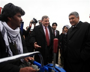 U.S. Ambassador Karl W. Eikenberry and Minister of Agriculture, Irrigation and Livestock Mohammad Asif Rahimi meet with a farmer
