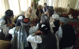 Tribal elders involved in dispute resolution meet with Shah Mohammad Khan, the district governor of Arghandab District, to discu
