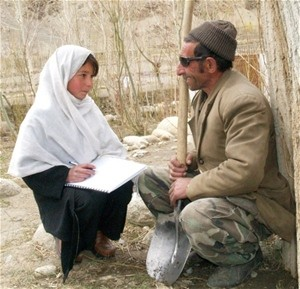 Twelve-year-old Seema interviews a local Wakhan farmer for a USAID-funded survey on livestock mortality. She is a member of one