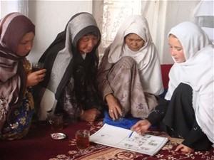 Female community health worker teaches Afghan mothers to improve hygiene in their homes through regular hand washing.
