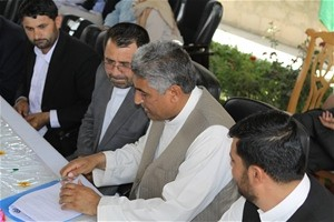Dr. Ihsan (far left), the majority owner of the Hilmand Ihsan Poultry Co. and Governor of Hilmand Mangal (left) look on as Minis