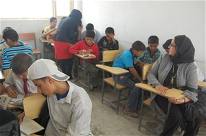 Shahla Dastyar observing her student, Mursal Sarwari, who is in tum teaching students at a high school in Kabul.
