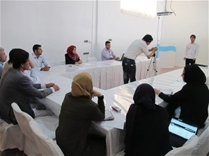 Members of women's organization and other Hirat citizens receive training in how to use a simple video camera at the new Hirat M