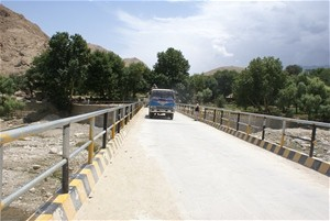 A truck crosses the Mamand Bridge.