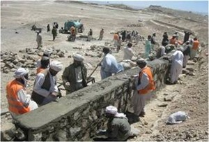 Workers building a retaining wall around the Segana Reservoir in Zarghun Shar District.