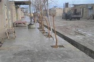 Tirin Kot's residents are pleased to have new concrete drains and sidewalks.